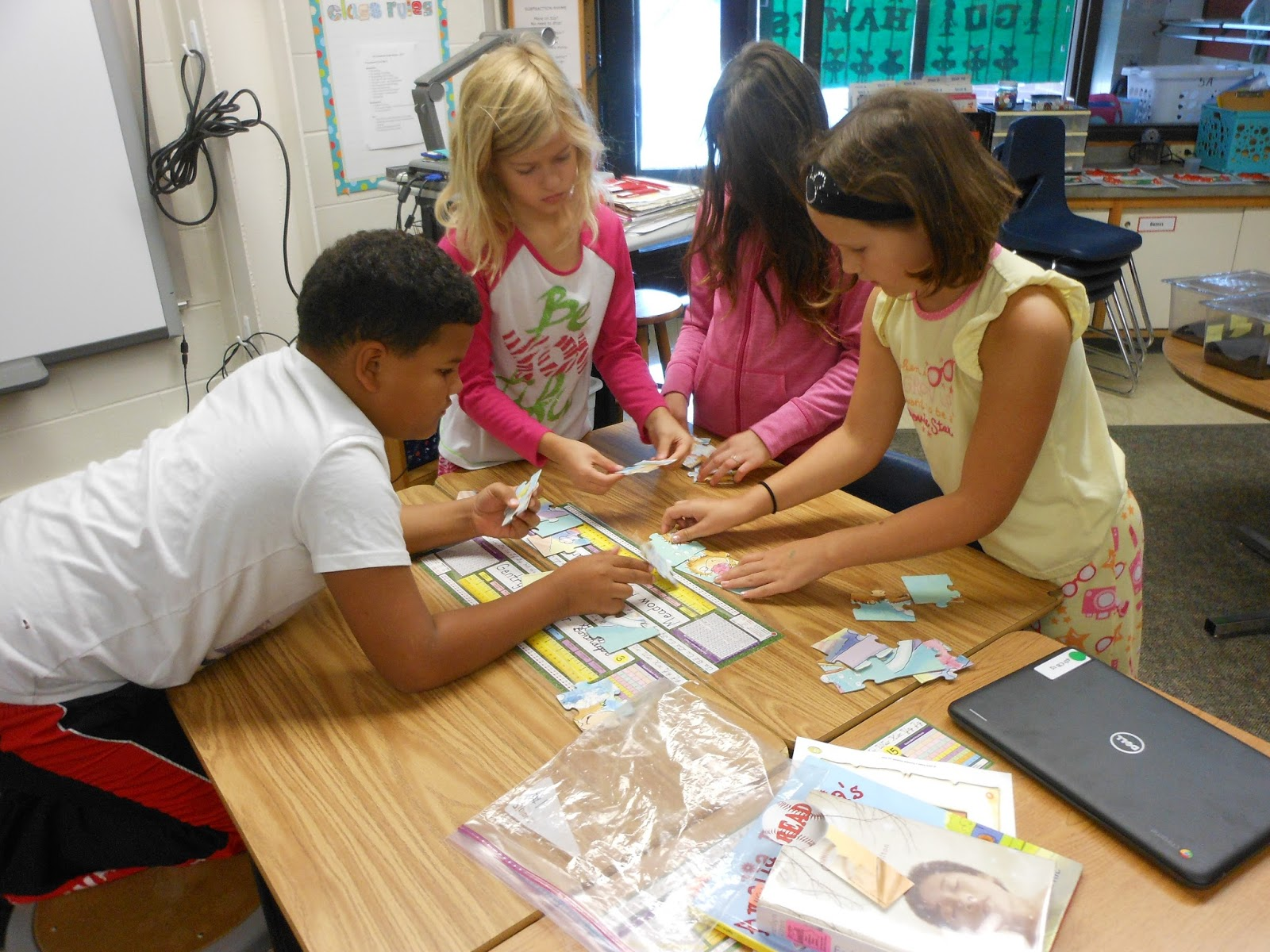 four students working on a puZZLE