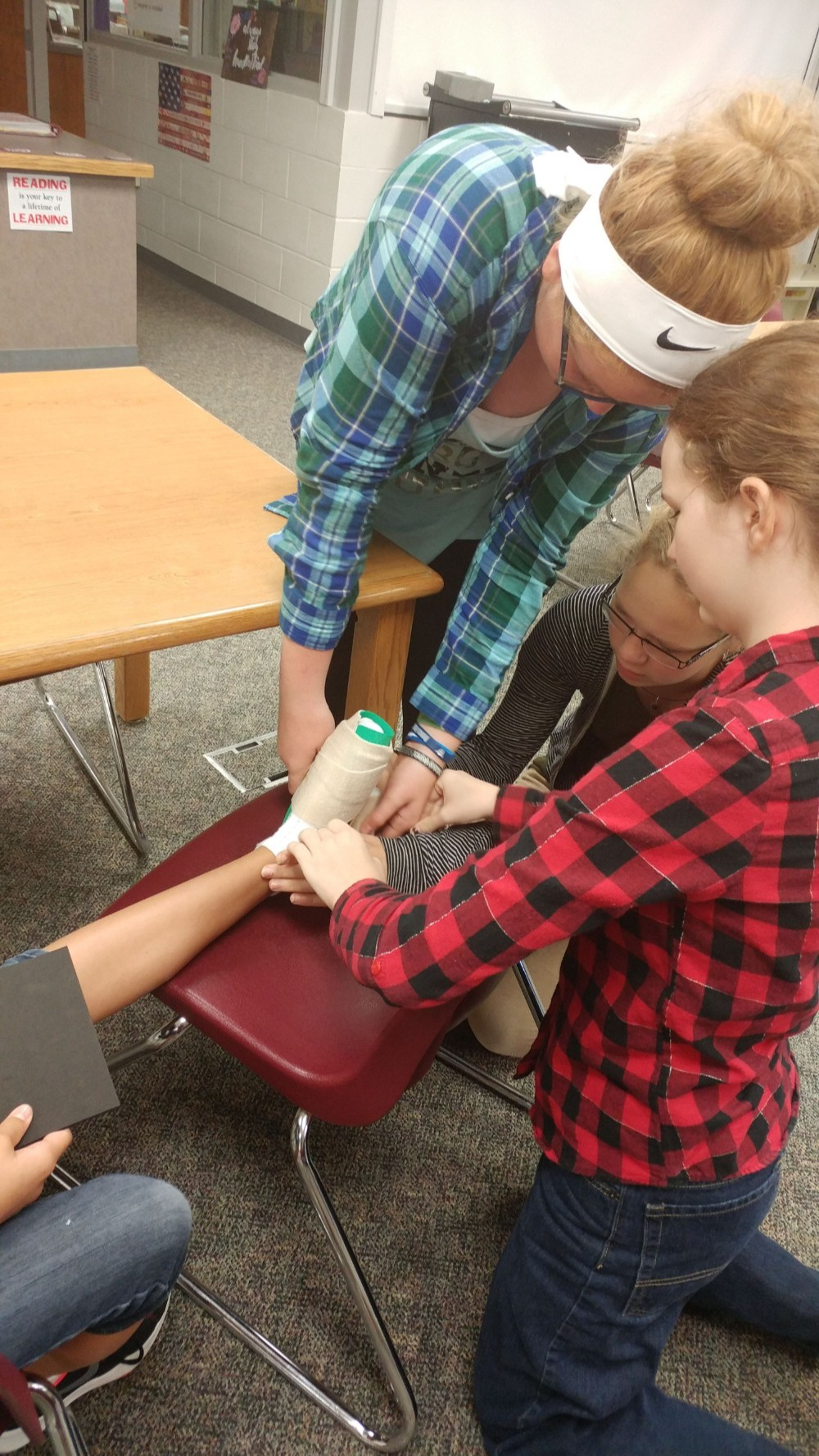 Three students creating a Foot orthosis prototype
