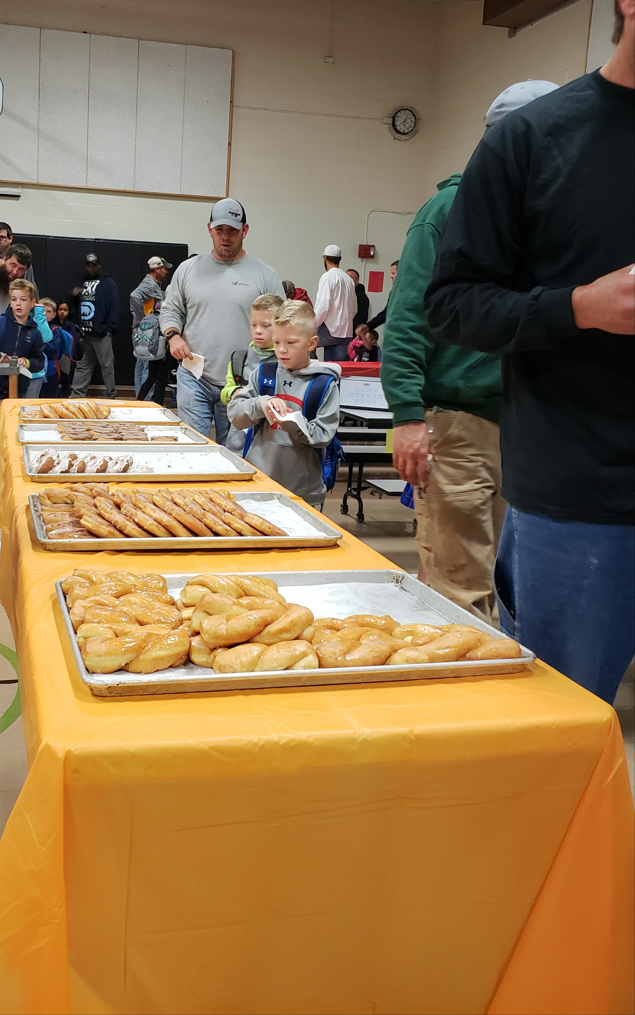 Students and their dads enjoy Donuts for Dad event