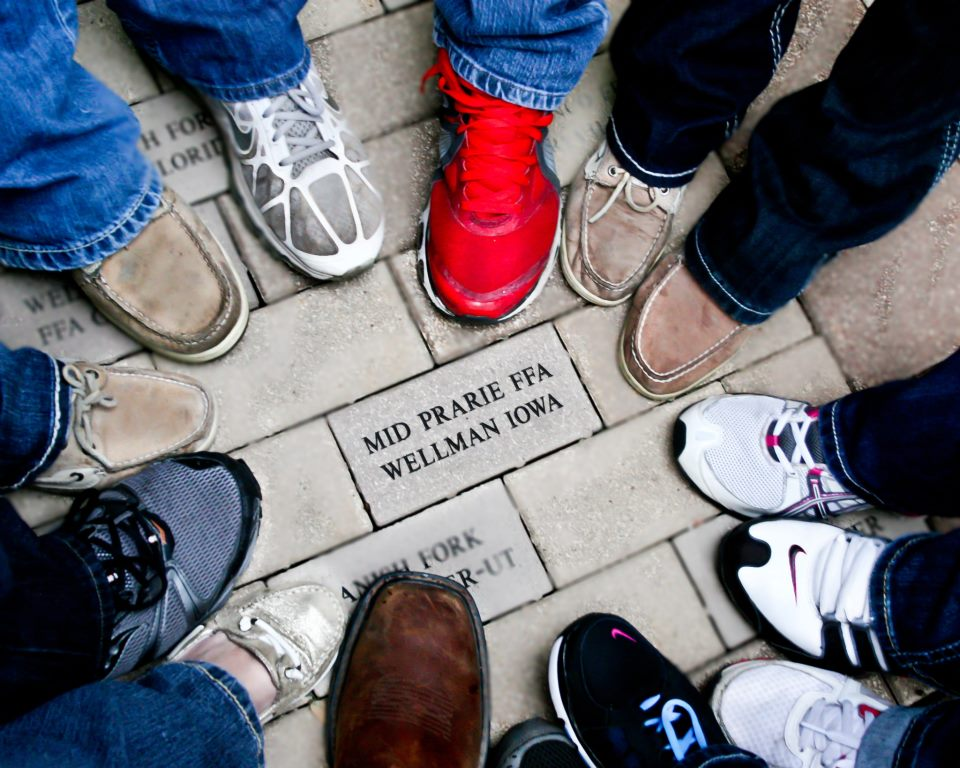 Students' shoes surrounding MP FFA brick