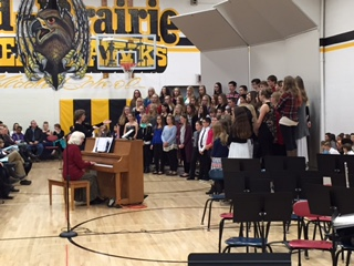 Middle School choir students performing at concert.