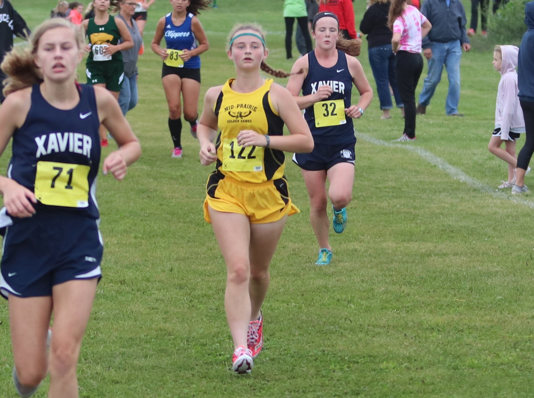 Shelby running at the cross country meet