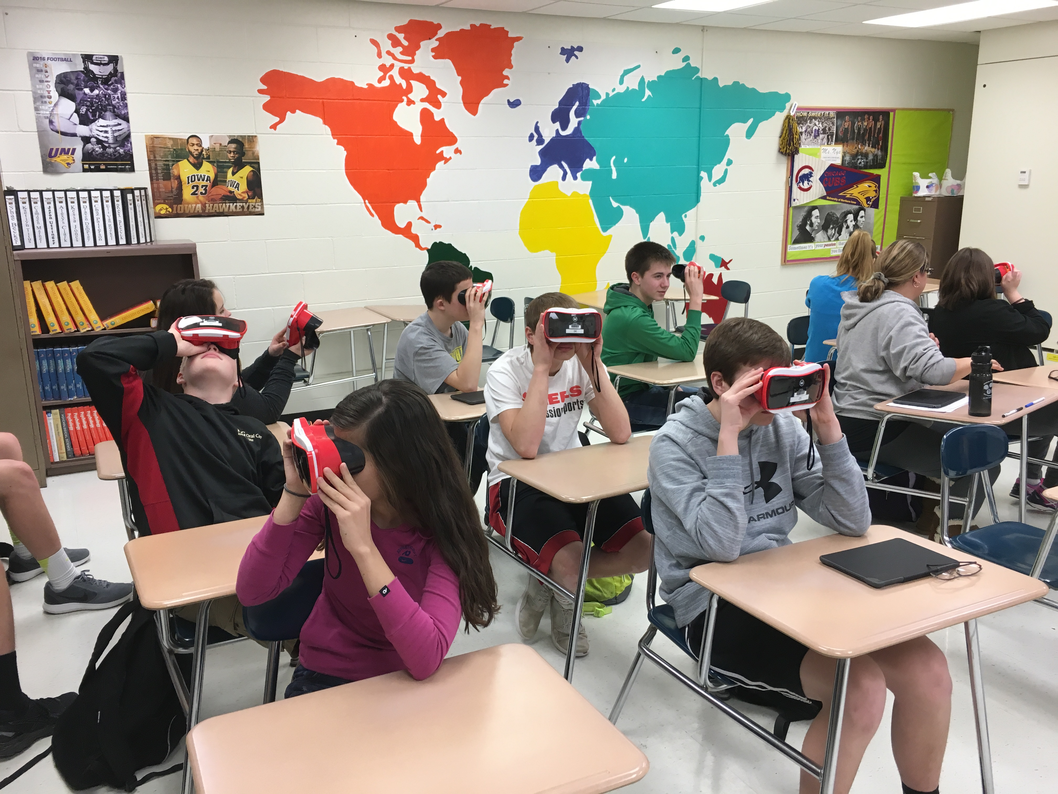 Students with virtual glasses on in a classroom